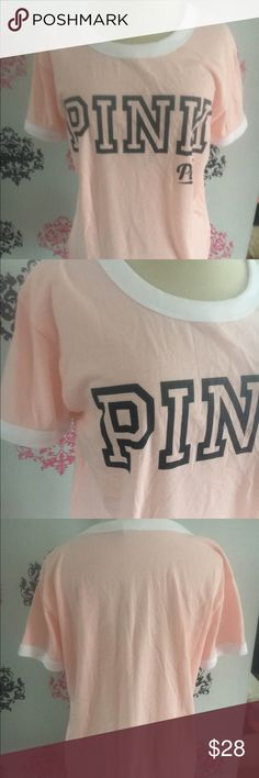 NWT Victoria secret pink large peach tee NWT PINK shirt large peach and white color with black letters. Very soft and comfy   All my items with increase in price due to new seller fee Victoria Secret, PINK, Bke, Rock revivals, miss me, true religion, express, buckle, affliction, sinful check out my closet! Ugg Australia. The North face PINK Victoria's Secret Tops Tees - Short Sleeve
