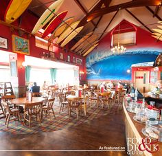 Ate in the surfboard lined Red Barn in Woolacombe a couple weeks ago. Super nice and good community vibes. Devon Uk, Devon England, Devon And Cornwall, North Devon, Uk Beaches, Beaches In The World, Places Around The World, Woolacombe Bay, Surf Cafe