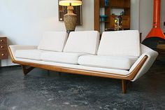 Adrian Pearsall gondola sofa. Cute orange fireplace hiding in the corner, too.