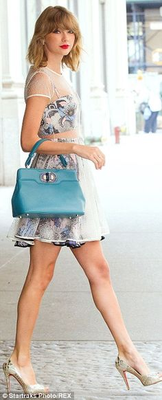Taylor Swift wore a Novis NYC design - a printed bustier and matching skirt with a sheer white overlay - styled with a dark teal Bulgari handbag and mirrored Christian Louboutin peep-toes.