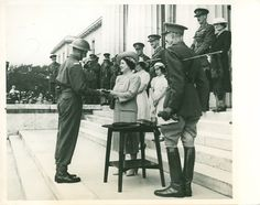 Queen Elizabeth honours the most efficient cadet at Sandhurst College, presenting to him a miniature silver sword. 8-10-1941.