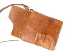 This listing is for one (1) Handmade Leather laptop/Messenger bag. This bag is unisex and you can hold your book , laptop or any other day to day items with style. ~100% top grade cow leather. ~Adjustable shoulder strap. ~Two inside packets (One small one big) Size info. 29