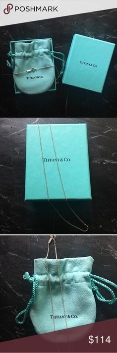"Tiffany & Co. Return To Tiffany 16"" Sterling Chain This delicate, silver Tiffany & Co. Chain adds a feminine touch to any pendant. Perfect as a gift or to hang your favorite charms. Comes with Tiffany box and pouch.  Authentic, purchased from the Towson, MD retail store.  📸 Item snapshot:  〰NWOT✨ 〰Approx 16"" Length✨ 〰Springring Clasp✨ 〰925 Sterling Silver✨ 〰Authentic Tiffany & Co. RTT✨ Tiffany & Co. Jewelry Necklaces"