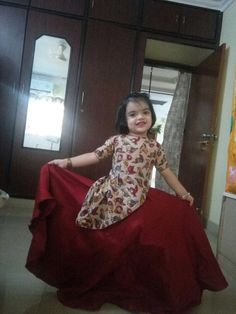 Out cute princess aadhya in our own design..ikkat cross cut top with cut shoulders and maroon lehenga