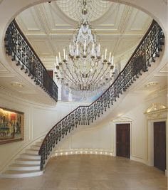 Incredible luxury staircase with beautiful chandelier.