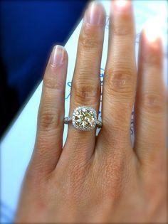 2.6 round canary diamond surrounded by 158 micro-paved white diamonds.