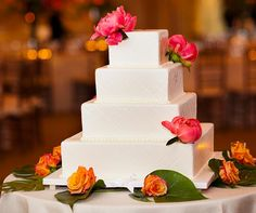 This sleek white wedding cake gets a pop of color from pink peonies and orange roses. Wedding Cakes With Cupcakes, Party Cakes, Cupcake Cakes, Mini Cakes, Beautiful Wedding Cakes, Dream Wedding, Wedding Day, Wedding Stuff, Wedding Flowers