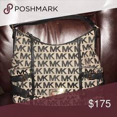 Michael Kors Signature Shoulder Bag Large Michael Kors Signature Jacquard Shoulder Bag-Black/Tan  This gorgeous bag is in excellent like new condition. It's both stylish and practical with its large size and multiple pockets.   Measurements: Strap drop- 8.5 inches Length- 13.5 inches Height- 10 inches  Width- 4 inches Michael Kors Bags Shoulder Bags