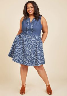 Wow on a Whim A-Line Dress | Mod Retro Vintage Dresses | ModCloth.com  Make a day of casual encounters an opportunity to impress with this chambray dress! From your favorite barista to colleagues aplenty, everyone will swoon for the ruffle-framed V-neck and pocketed, floral skirt of this charming A-line from our ModCloth namesake label, solidifying your rep as the locally-loved fashionista.