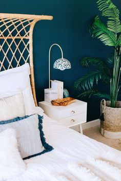 This bohemian bedroom is a dream! Decorist designed a natural, serene space anchored by a deep blue/green wall color that is nothing short of exquisite.