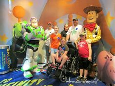 Taking a picture with Buzz Lightyear and Woody from Toy Story.