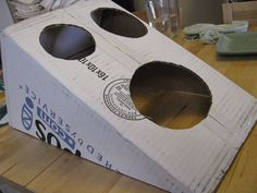 bean bag toss out of cardboard box.  Use this for a Superhero party and decorate with the words Pow, Bam, etc.