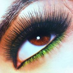 Beautiful eyes, long lashes, & green eye liner<3