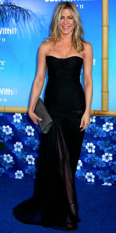 February 9, 2011  Jennifer Aniston walked the Just Go With It blue carpet in a Dolce & Gabbana dress, vintage Fred Leighton jewels and a custom Burberry alligator clutch.