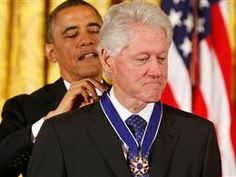 U.S. President Barack Obama presents the Presidential Medal of Freedom to former U.S. President Bill Clinton : nbcnews  11/20/13