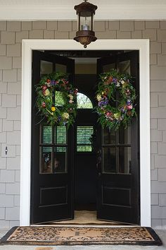 This inspirational entry offers the simplicity of black doors with lots of window panes and an overhead lamp (get the look with Acclaim Lighting from Walton Collection) to guide the way from guest blo (How To Make Curtains For French Doors) Black Front Doors, Double Front Doors, Front Entry, Front Porch, Interior Exterior, Exterior Doors, Porches, Entrance Doors, Door Entry