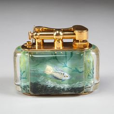 Nicholas Wells Antiques have handled some of the finest Dunhill Aquarium Table Lighters.