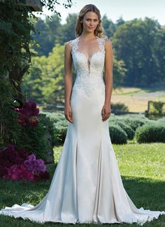 Fit and flare stretch Satin gown featuring a Queen Anne neckline, nude side panels and back, beaded embroidered lace, and a chapel length train. https://www.sinceritybridal.com/wedding_dress/3921