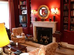 Doing ours red tonight with white fireplace Living Room Styles, Living Room Red, Living Room Colors, Living Spaces, Red Armchair, Cosy Lounge, Dark Wood Furniture, White Fireplace, Red Sofa