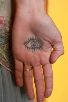 Hamsa Tattoo. If I could get this I so would.  To bad I work with the public.  Some day..