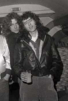 """http://custard-pie.com Robert Plant and Jimmy Page of Led Zeppelin aboard the band's private jet, """"The Starship"""""""