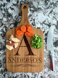 Premier Serving Boards - Personalized - Our beautiful Premier Serving Boards are intricate in detail and personalized with family names. A truly thoughtful and useful gift for any gift giving occasion.   The serving boards each have a hole drilled through the end of the handle, perfect for hanging.