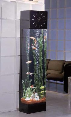 long Fish tank. good to tell the time.beautiful in your play room.