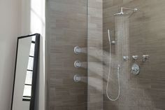 The Arris™ collection from Moen features tub and shower packages and a ten-inch rainshower for creating the perfect vertical spa experience. #KBIS2013 #bathroom #ModernDesign