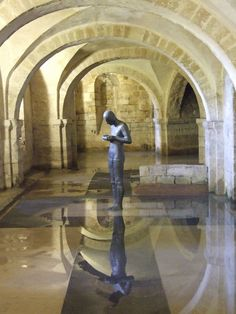 "Sculpture by Anthony Gormley - ""Sound II"" - in the Crypt of Winchester Cathedral"