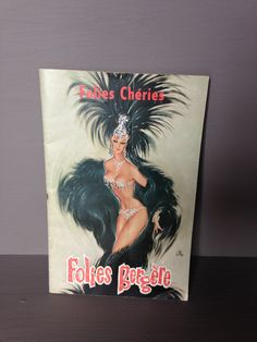Souvenir programme from the famous Parisian show - Les Folies Bergère, directed by Michel Gyarmathy c. 1961. Cover illustration in colour would frame beautifully, inside includes many vintage adverts from the 1960s including Perrier, Coca cola, BOAC, BEA. Size 13.5cm x 21cm.     Items are shipped by French Collissimo, a tracked service which arrives within 3 business days from posting. Postage costs can be combined if purchasing multiple items, please enquire for other options.  Merci.