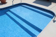 In Ground Vinyl Liner Swimming Pool With Full Width Steps, Custom Sun Deck, and Deck Jets, Raft to Rafters Pool and Spa, Columbus, Indiana.
