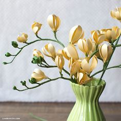 Handcrafted lifestyle expert Lia Griffith shows you how to make a paper freesia for your DIY home and wedding decor using her template and photo tutorial!
