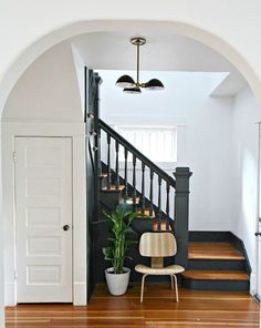 Black stairs: Benjamin Moore Midnight Oil (1631) in Eggshell. Walls are BM Decorators White (CC-20) in Eggshell.