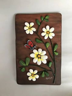 Items similar to Flower picture rocks on Etsy- Items similar to Flower picture rocks on Etsy floral painting entirely handmade. the base is shaped by hand in wood. the decorations are made of painted stones. each piece is a unique piece. Stone Crafts, Rock Crafts, Diy And Crafts, Arts And Crafts, Pebble Painting, Pebble Art, Stone Painting, Rock Flowers, Rock And Pebbles