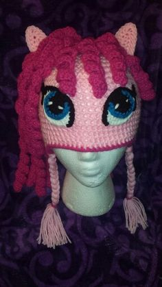"A hat inspired by ""Pinkie Pie"" from ""My Little Pony"" You can purchase the pattern from its creator at this link https://www.etsy.com/listing/162805534/crochet-unicorn-pony-hat-pattern-pdf?ref=ss_listing"