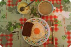 DaySeven, Breakfast is the most important meal of the day! Fried egg, whole grain bread, curd cheese with honey & cappuccino.