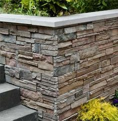 Use cast-concrete stone-veneer panels and masonry screws to dress up a plain wall—no mortar required