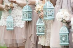 Instead of flowers, these bridesmaids carried lovely, jeweled lanterns that paired perfectly with their dusty rose dresses - via Whimsical Wonderland Weddings