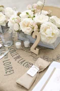 Grey box on top of burlap provides a great contrast. Add blue and green in your flowers.