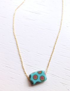 Thin gold chain necklace with polka dotted blue by SubtleTrees