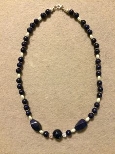 The Melissa Collection features a delightful mixture of Navy Blue Swirl beads, Navy Blue Round Pearls, Navy Blue Round beads, White Oval beads, Silver Corrugated beads, and Silver Daisy Spacers. Navy Blue rules the day!! Melissa B