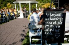 """""""As two families are becoming one, we ask that you choose a seat and not a side"""" rustic wedding chalkboard sign"""