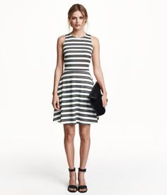 Short, sleeveless dress in jersey with a seam at waist, racer back, and circle skirt.
