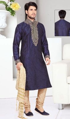 Shake off all your dark moods and brighten your day with this navy blue art silk men's kurta pyjama. The ethnic resham and stones work for kurta adds a sign of attractiveness statement for your look. #Men'sShervani