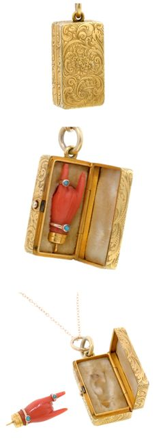 Antique Coral Hand Pendant In Engraved Fitted rectangular box/pendant the engraved box of scroll & floral design holds a coral hand (mano cornuta or horned hand) charm with turquoise ring & bracelet  Circa 1860.  from Doyle & Doyle
