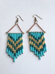 Turquoise Teal and Gold Chevron Earrings. $23.00, via Etsy.