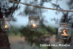 Liven up your next yard party with these hanging mason jar lights! DIY. www.cedarhillfarmhouse.com