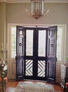 Glossy black doors + Chippendale design on bottom of screen doors