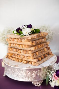 A Churro Cake is a delicious alterntative to the traditional cake. It can still be decorated with flowers and placed on a cake stand to give it a chic wedding look!