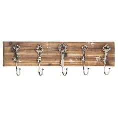 Hang scarves and pet leashes on this wood wall rack, featuring 5 key-shaped hooks for a touch of rustic charm.    Product: Wal...